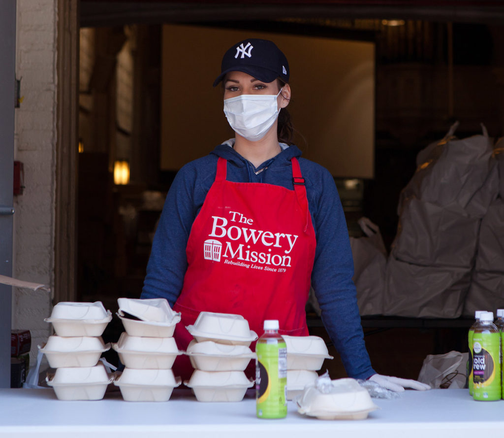 Volunteer serving meals